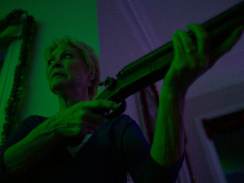 Dee Wallace Gun Green – Red Christmas Photo by Douglas Burgdorff